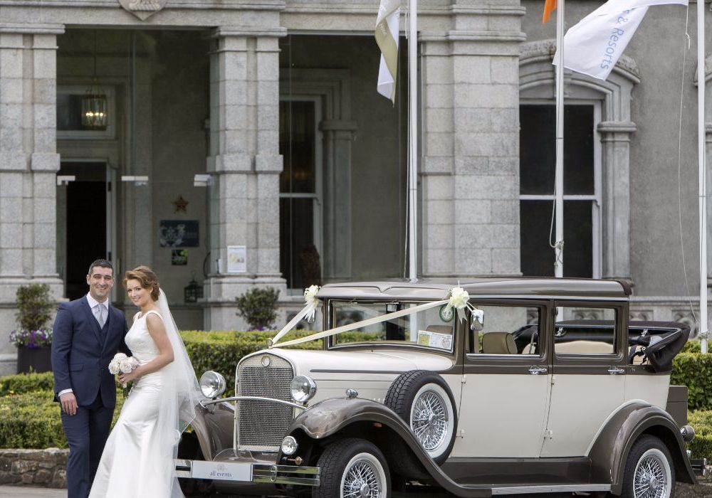 Faithlegg Exterior Bride and Groom with Car 4